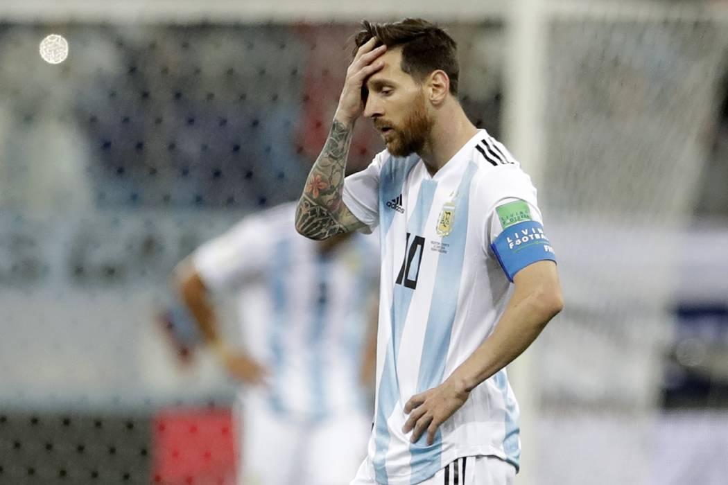 Argentina's Lionel Messi reacts after the third goal of Croatia during the group D match between Argentina and Croatia at the 2018 soccer World Cup in Nizhny Novgorod Stadium in Nizhny Novgorod, R ...