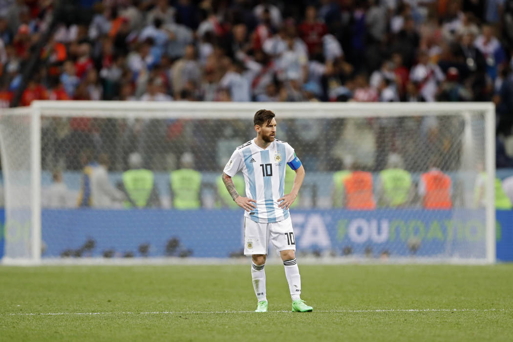 Argentina's Lionel Messi stands on the pitch at the end of the group D match between Argentina and Croatia at the 2018 soccer World Cup in Nizhny Novgorod Stadium in Nizhny Novgorod, Russia, Thurs ...