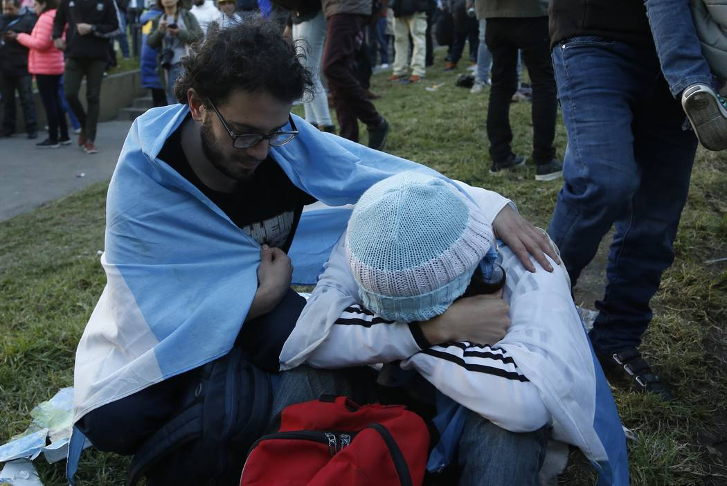 An Argentina fan comforts a friend at the end of a televised broadcast of the Croatia vs Argentina World Cup soccer match, in Buenos Aires, Argentina, Thursday, June 21, 2018. Argentina lost 3-0 t ...