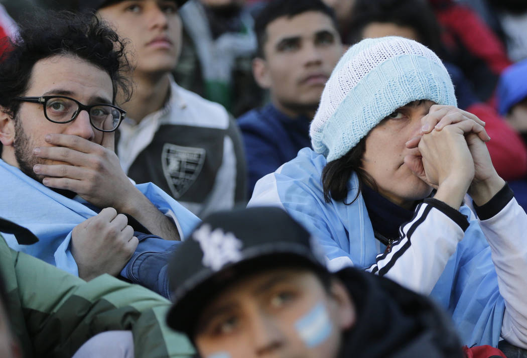 Argentina fans react in disbelief at the end of a televised broadcast of the Croatia vs. Argentina World Cup soccer match, in Buenos Aires, Argentina, Thursday, June 21, 2018. Argentina lost 3-0 t ...