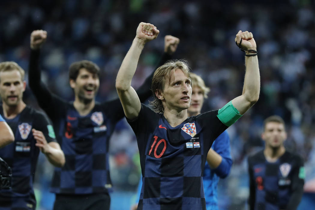 Croatia's Luka Modric celebrates with teammates at the end of the group D match between Argentina and Croatia at the 2018 soccer World Cup in Nizhny Novgorod Stadium in Nizhny Novgorod, Russia, Th ...