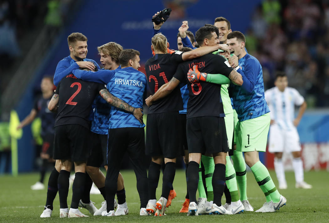 Croatia players celebrate their side's 3-0 victory at the end of the group D match between Argentina and Croatia at the 2018 soccer World Cup in Nizhny Novgorod Stadium in Novgorod, Russia, Thursd ...