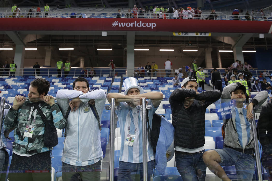 Fans of Argentina lean against the security glass after their side's 0-3 lost against Croatia during the group D match at the 2018 soccer World Cup in Nizhny Novgorod, Russia, Thursday, June 21, 2 ...