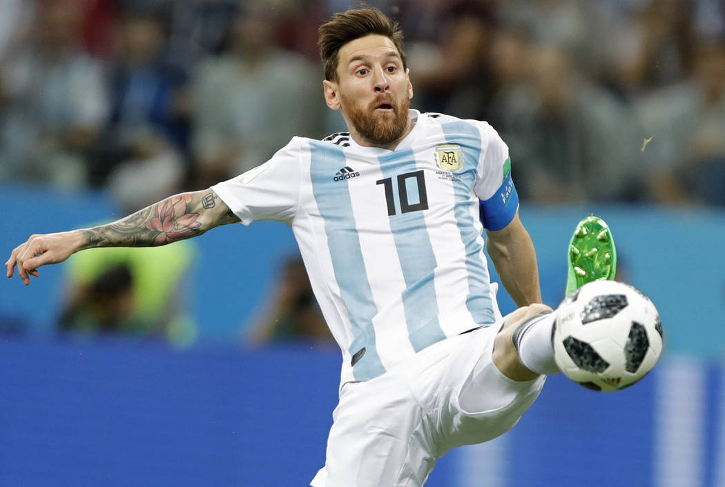 Argentina's Lionel Messi reaches for the ball during the group D match between Argentina and Croatia at the 2018 soccer World Cup in Nizhny Novgorod Stadium in Nizhny Novgorod, Russia, Thursday, J ...