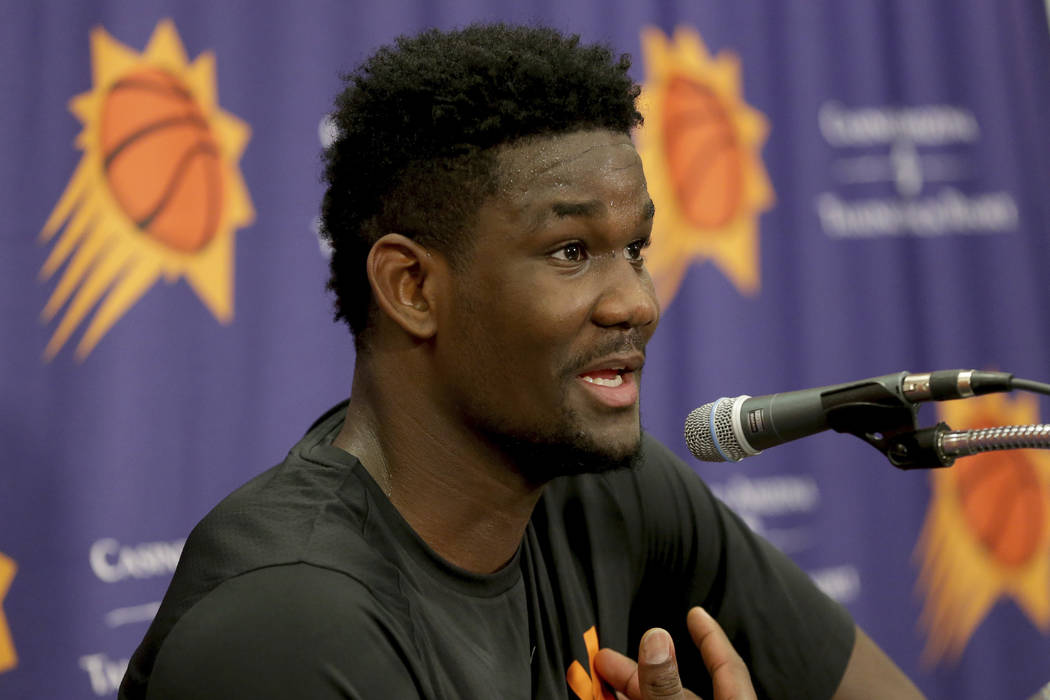 NBA Draft prospect Deandre Ayton, who may be the Phoenix Suns' choice with the No. 1 overall pick in this month's NBA draft, talks to the media after an individual workout with the Suns, Wednesday ...