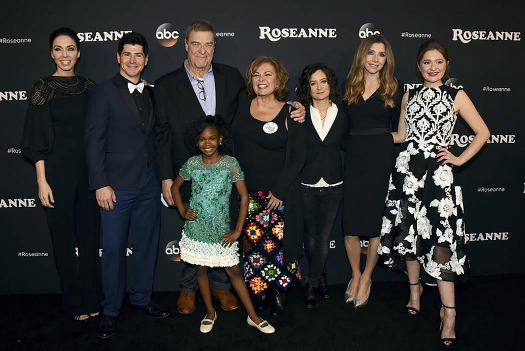 "From left, Whitney Cummings, Michael Fishman, John Goodman, Jayden Rey, Roseanne Barr, Sara Gilbert, Sarah Chalke and Emma Kenney arrive at the Los Angeles premiere of ""Roseanne"" in Burbank, Calif ..."