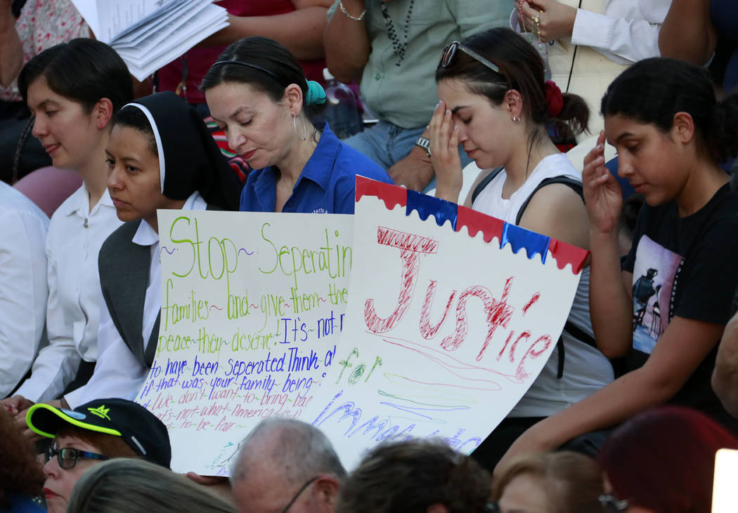 People gather at St. Mark Catholic Church for a solidarity with migrants vigil, Thursday, June 21, 2018 in El Paso, Texas. President Donald Trump's order ending the policy of separating immigrant ...