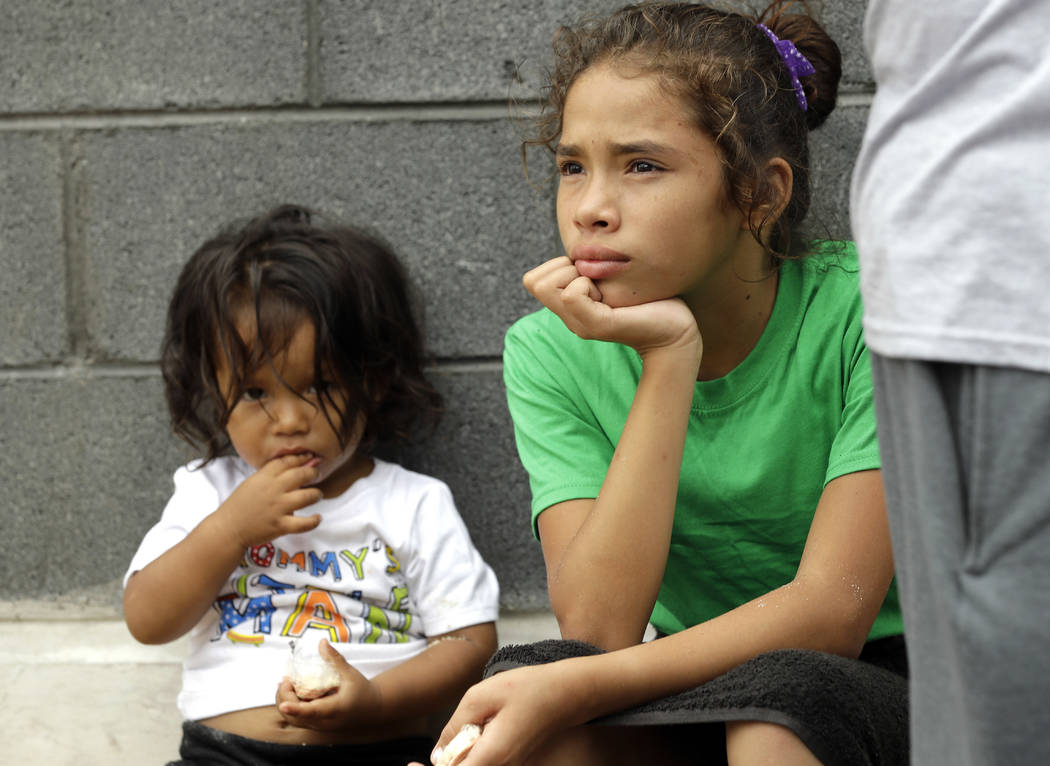 Angui Funes, right, sits with her brother, Jesus, after crossing the border back to Reynosa, Mexico, Thursday, June 21, 2018. The family, who was seeking asylum, said they were told by officials t ...