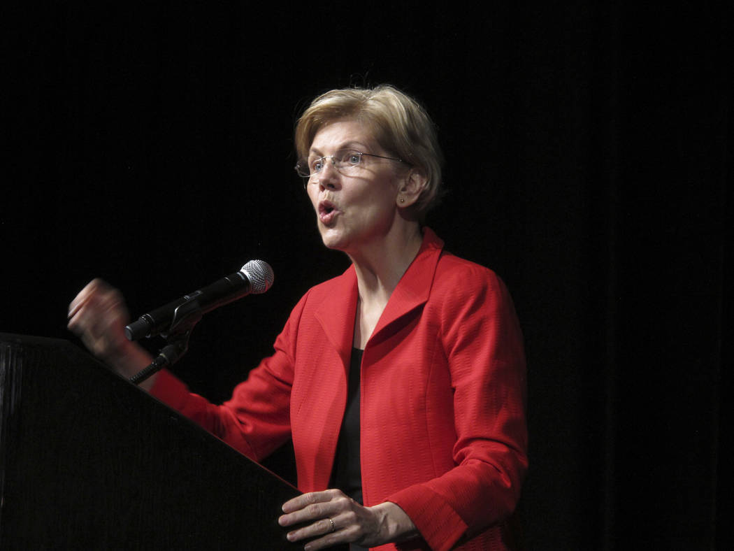 Sen. Elizabeth Warren, D-Mass., delivers the keyonte address Saturday, June 23, 2018, to the Nevada Democratic Convention in Reno, Nev. She said Nevada will play a pivotal role in the November ele ...