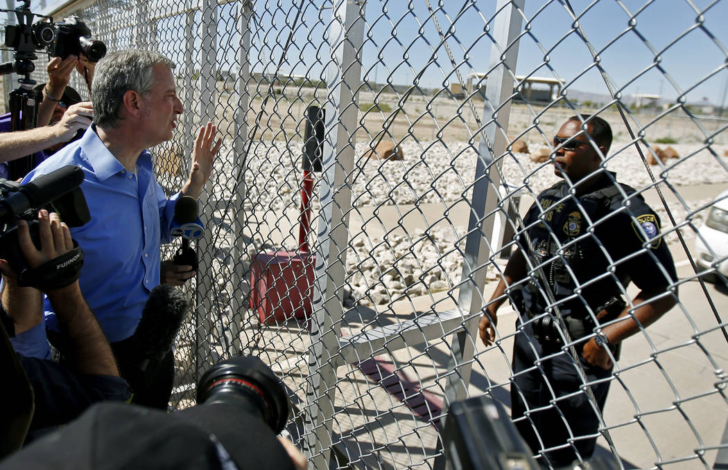 New York City Mayor Bill de Blasio, left, requests entrance to the holding facility for immigrant children in Tornillo, Texas, near the Mexican border, Thursday, June 21, 2018. About 20 mayors fro ...