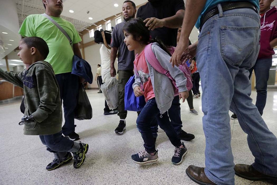 A group of immigrants from Honduras and Guatemala seeking asylum arrive at the bus station after they were processed and released by U.S. Customs and Border Protection, Thursday, June 21, 2018, in ...