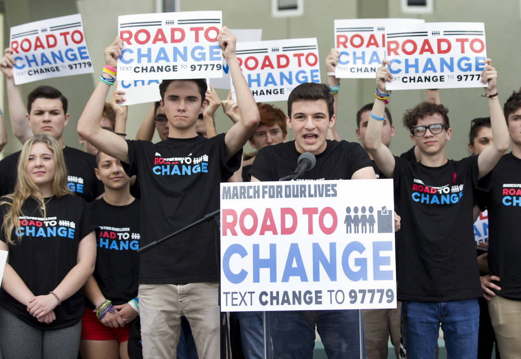 Cameron Kasky, center, speaks during a news conference, Monday, June 4, 2018, in Parkland, Fla. A day after graduating from high school, a group of Florida school shooting survivors has announced ...