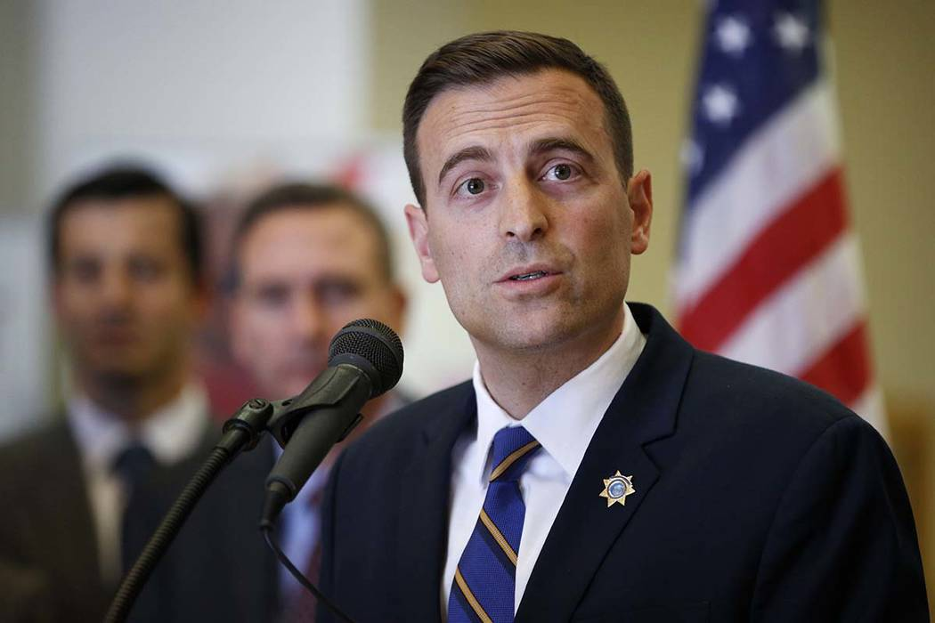 Nevada state Attorney General Adam Paul Laxalt speaks at a news conference on a lawsuit against Purdue Pharma, Tuesday, May 15, 2018, in Las Vegas. (AP Photo/John Locher)