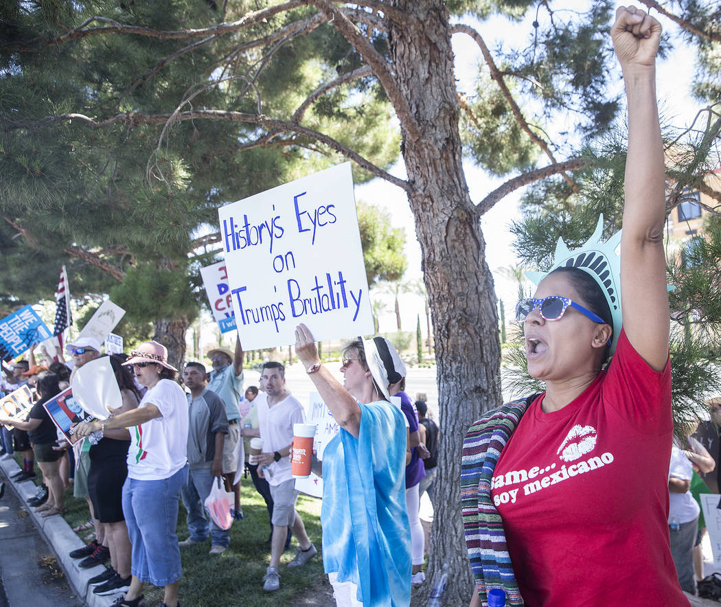 Lucinda Long, right, protests outside Suncoast hotel-casino ahead of President Donald Trump's appearance on Saturday, June 23, 2018, in Las Vegas. Benjamin Hager Las Vegas Review-Journal @benjamin ...