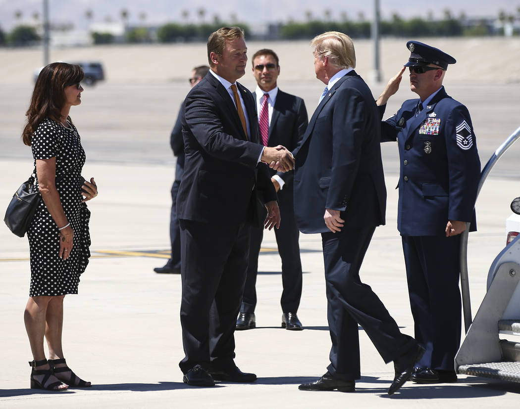 President Donald Trump greets U.S. Sen. Dean Heller, R-Nev., after arriving at McCarran International Airport in Las Vegas on Saturday, June 23, 2018. Chase Stevens Las Vegas Review-Journal @csste ...