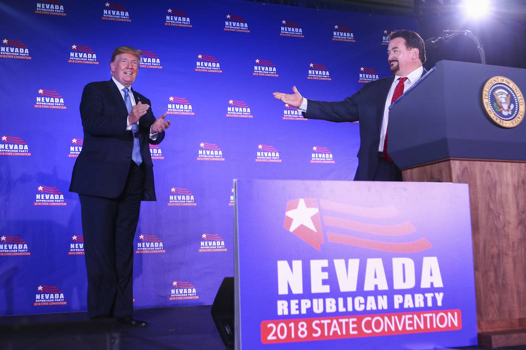 President Donald Trump is introduced by Nevada Republican Party Chairman Michael McDonald during the keynote address at the Nevada Republican Party State Convention at the Suncoast in Las Vegas on ...