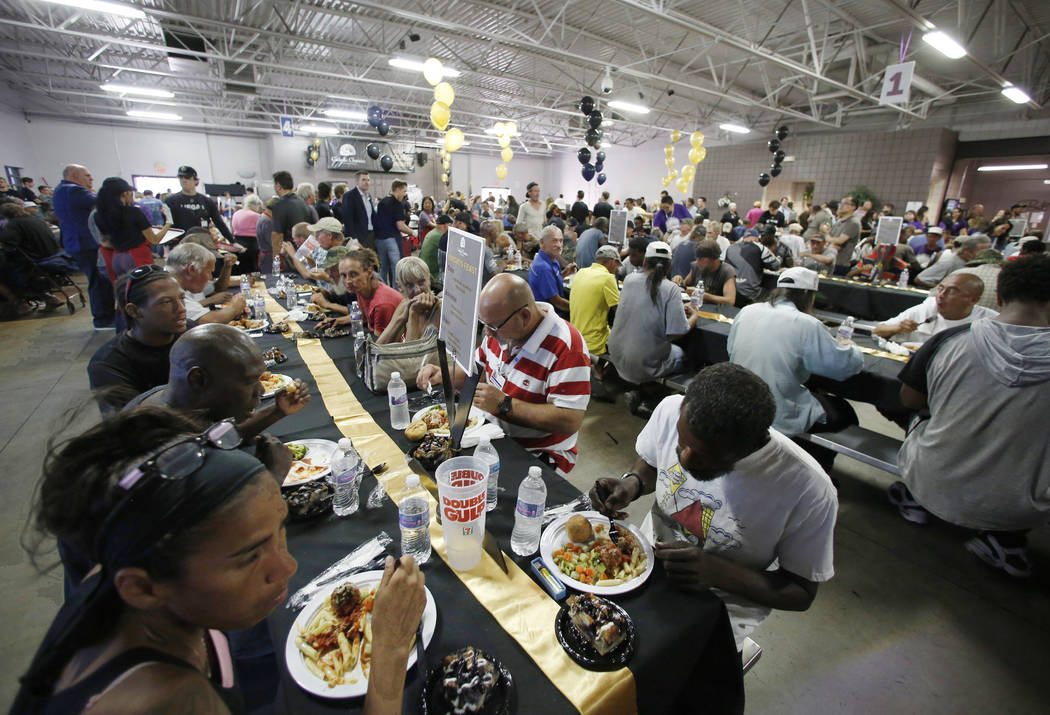 Clients enjoy their special free community meal at Catholic Charities of Southern Nevada on Monday, June 25, 2018, in Las Vegas. Vegas Golden Knights prospects and staff members have served a spec ...