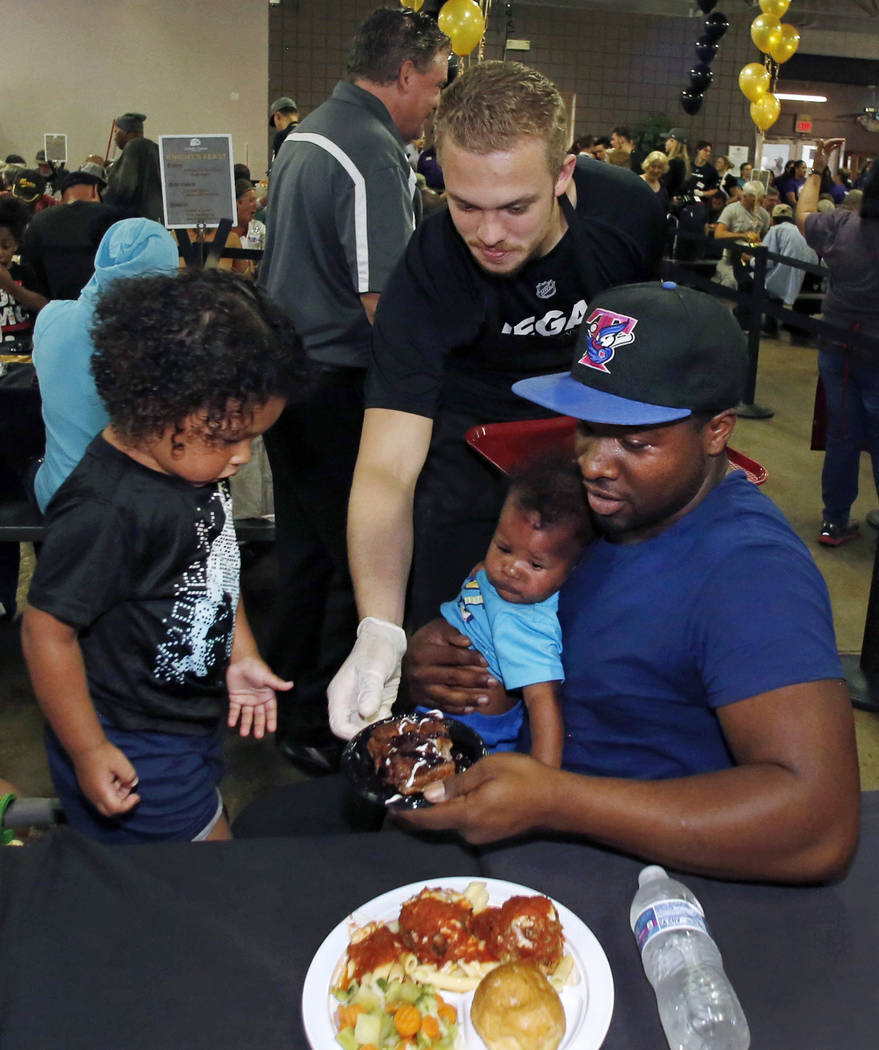 The Vegas Knight prospect Lucas Elvenes serves a special free community meal to clients at Catholic Charities of Southern Nevada on Monday, June 25, 2018, in Las Vegas. Vegas Golden Knights prospe ...