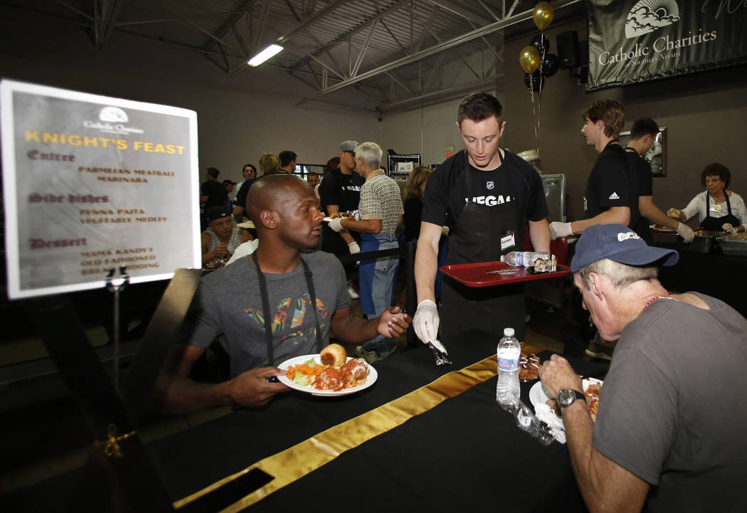 The Vegas Knight prospect Ben Jones serves a special free community meal to clients at Catholic Charities of Southern Nevada on Monday, June 25, 2018, in Las Vegas. Vegas Golden Knights prospects ...