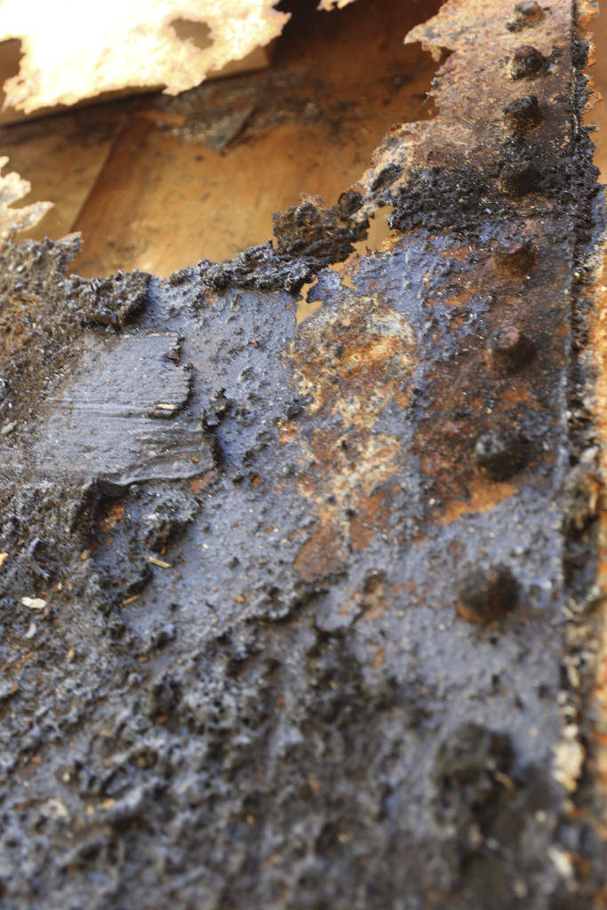 Rusted steel from a relic of the USS Arizona sits in a crate while waiting to be loaded onto an airplane Thursday, June 21, 2018, in Honolulu. (AP Photo/Audrey McAvoy)
