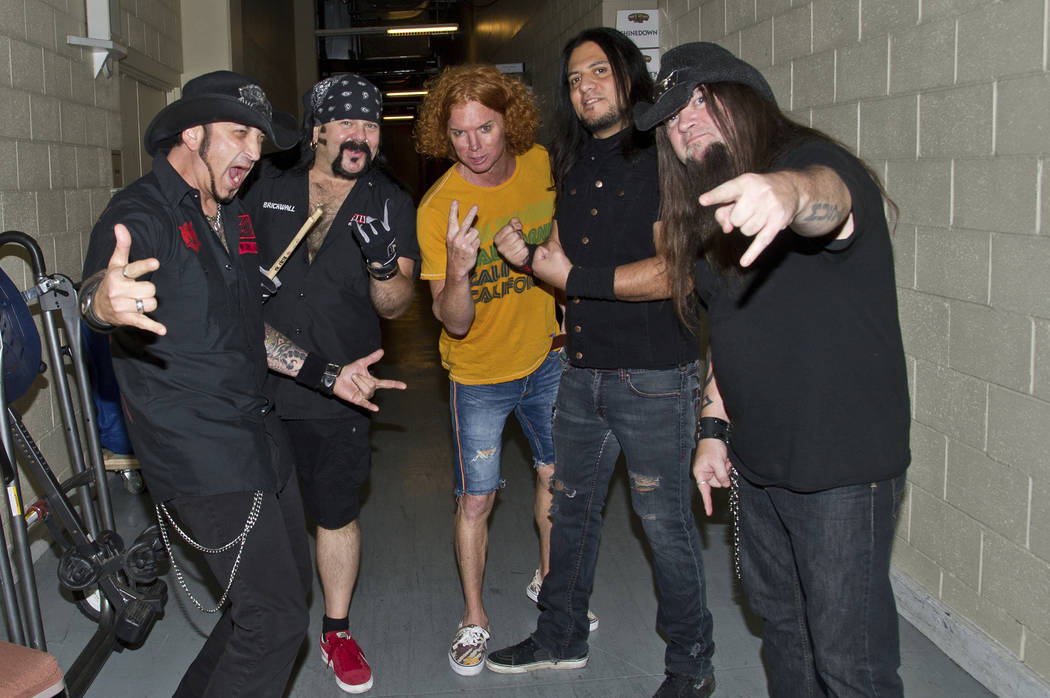 Carrot Top poses with Tom Maxwell, Vinnie Paul, Bob Zilla, and Greg Tribbett of Hellyeah during the Rock Vegas Music Festival at Mandalay Bay on Sept. 28, 2012, in Las Vegas. (Photo by Amy Harris/ ...