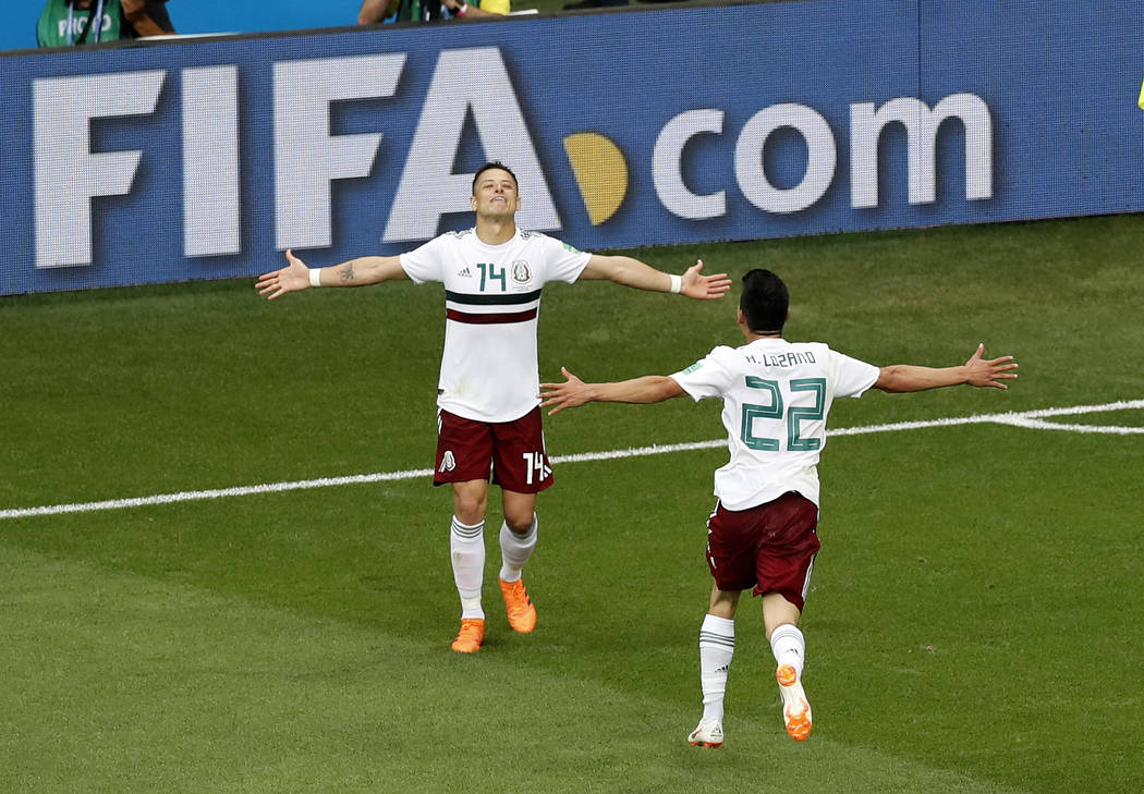 Mexico's Javier Hernandez, left, celebrates with teammate Hirving Lozano after scoring his teams second goal during the group F match between Mexico and South Korea at the 2018 soccer World Cup in ...