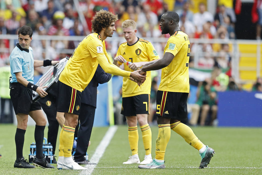 Belgium's Romelu Lukaku, right, leaves the pitch as being substituted for teammate Marouane Fellaini during the group G match between Belgium and Tunisia at the 2018 soccer World Cup in the Sparta ...
