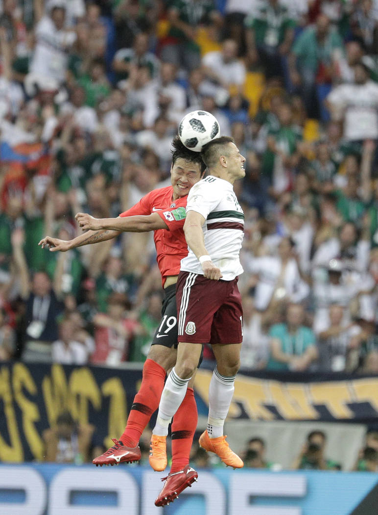 South Korea's Kim Young-gwon, left, jumps for a header with Mexico's Javier Hernandez during the group F match between Mexico and South Korea at the 2018 soccer World Cup in the Rostov Arena in Ro ...