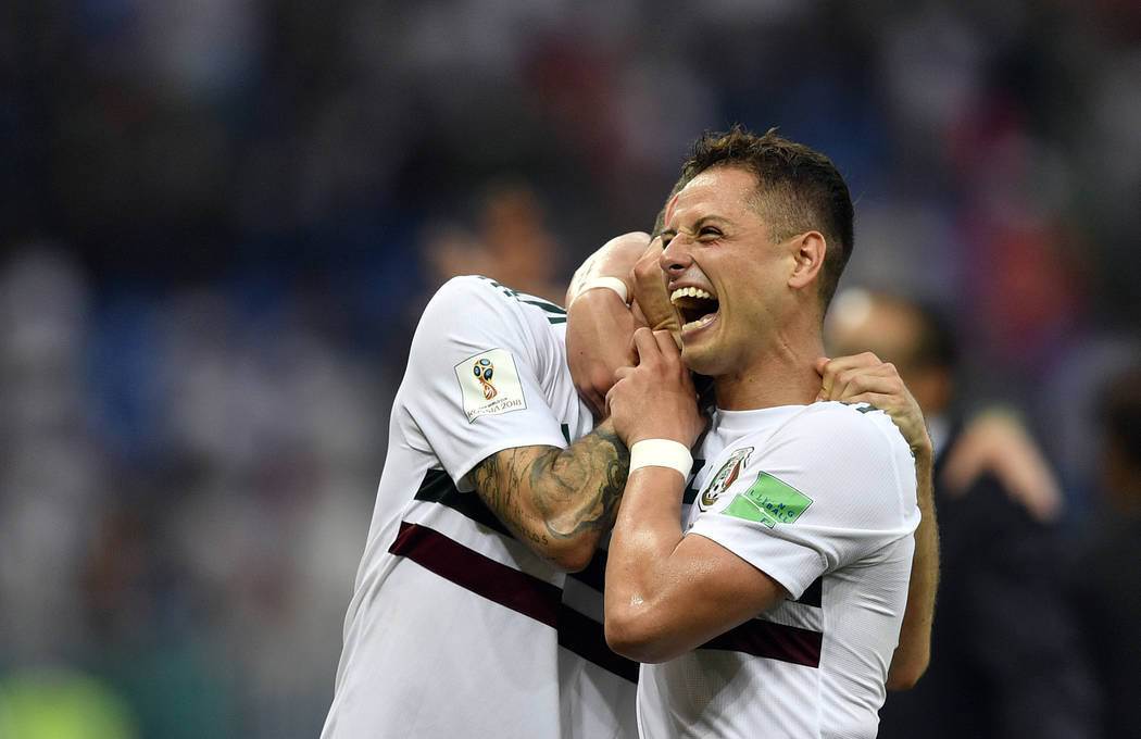 Mexico's Javier Hernandez, right, and Miguel Layun celebrate at the end of the group F match between Mexico and South Korea at the 2018 soccer World Cup in the Rostov Arena in Rostov-on-Don, Russi ...