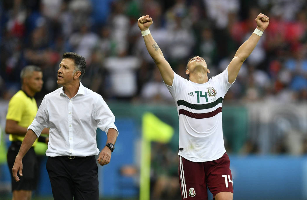 Mexico's Javier Hernandez celebrates beside Mexico head coach Juan Carlos Osorio, left, at the end of the group F match between Mexico and South Korea at the 2018 soccer World Cup in the Rostov Ar ...