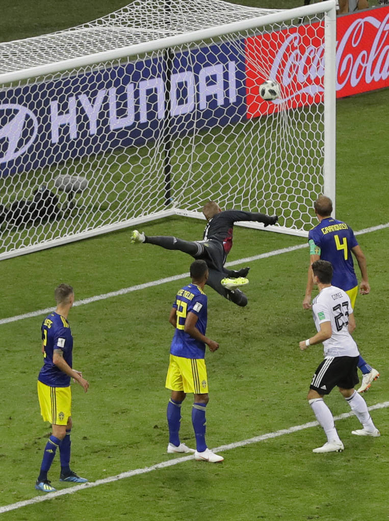 Sweden goalkeeper Robin Olsen, fails to save goal from Germany's Toni Kroos, during the group F match between Germany and Sweden at the 2018 soccer World Cup in the Fisht Stadium in Sochi, Russia, ...