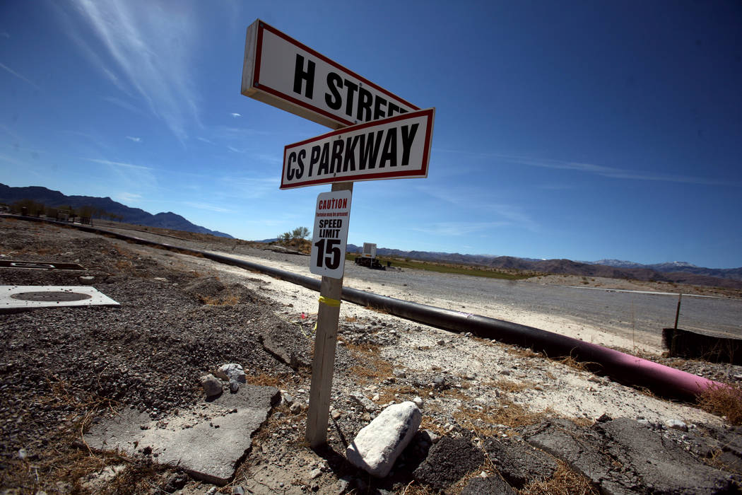 The intersection of Coyote Springs Parkway and H Street at the Coyote Springs master plan community, located on U.S. 93 about 60 miles northeast of Las Vegas, Tuesday, March 20, 2012. The 40,000 a ...