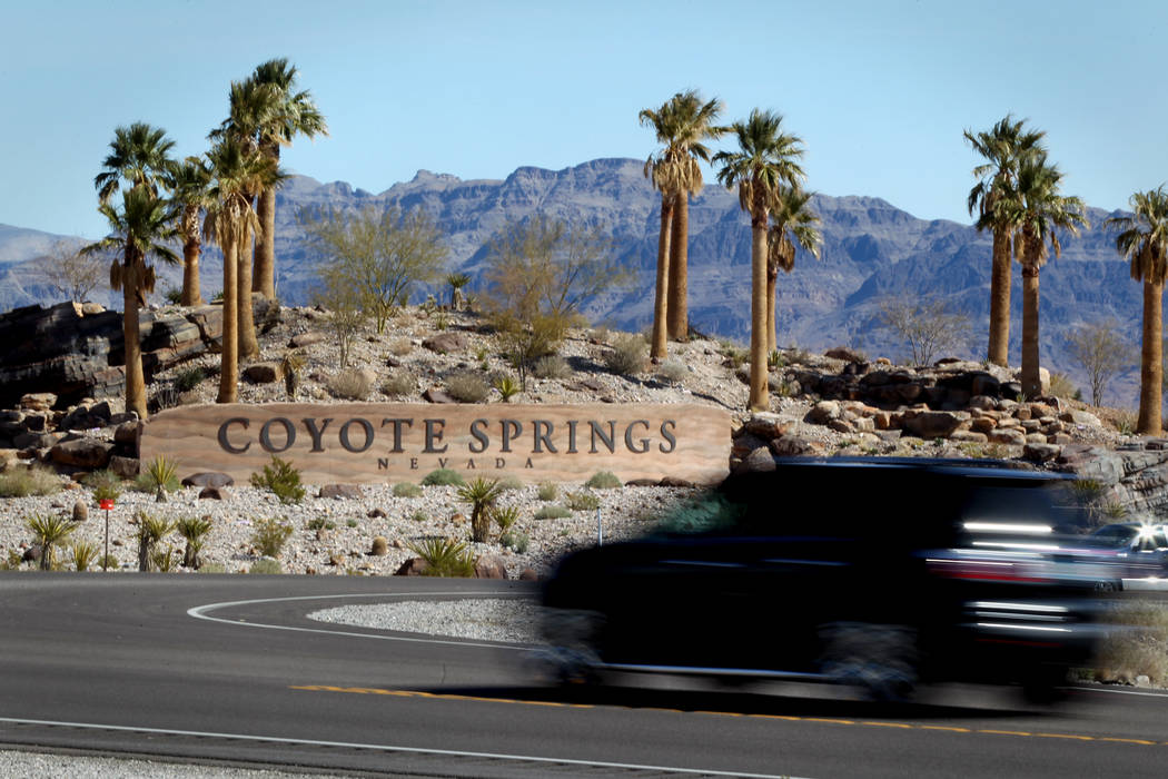 A vehicle passes the entrance of Coyote Springs developmet, located on U.S. 93 about 60 miles northeast of Las Vegas,Tuesday, March 20, 2012. The 40,000 acre development and was planning on buildi ...