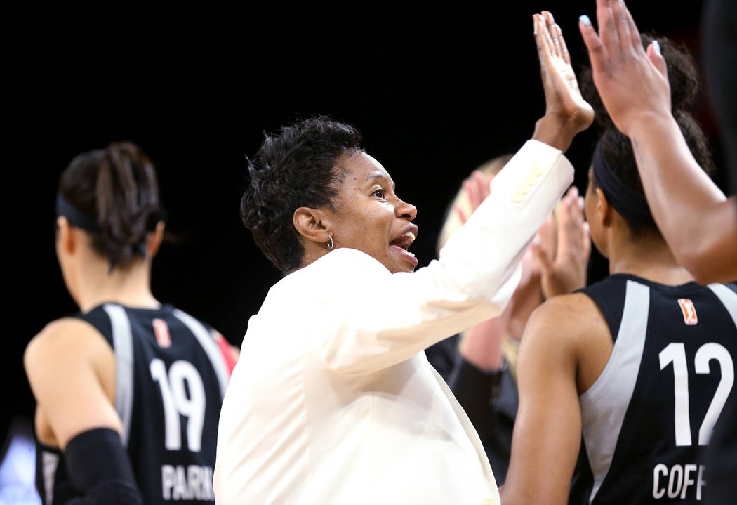 Las Vegas Aces assistant coach Vickie Johnson high-fives players at they prepare to take on the New York Liberty in a WNBA basketball game at the Mandalay Bay Events Center in Las Vegas Sunday, Ju ...