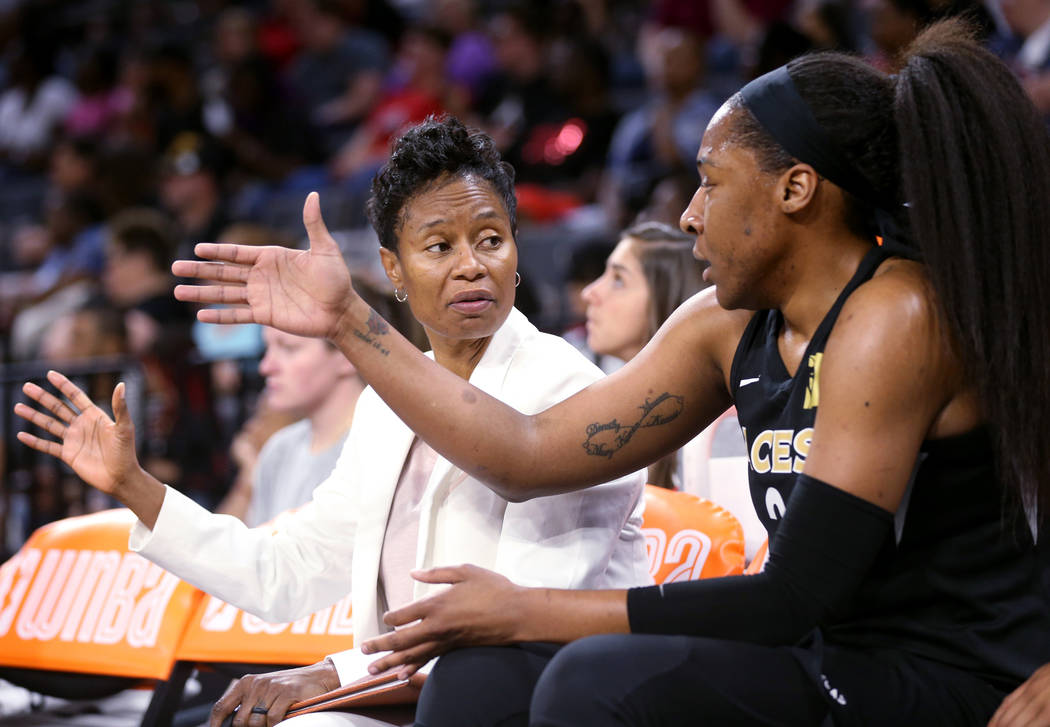 Las Vegas Aces assistant coach Vickie Johnson talks to Aces center Kelsey Bone (3) during a WNBA basketball game against the New York Liberty at the Mandalay Bay Events Center in Las Vegas Su ...