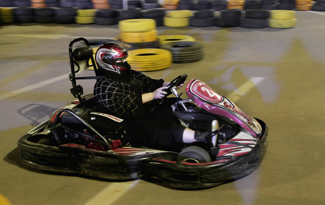 In this June 22, 2018 photo, a woman drives a go cart at a road safety event for female drivers launched at the Riyadh Park Mall in Saudi Arabia. (AP Photo/Nariman El-Mofty)