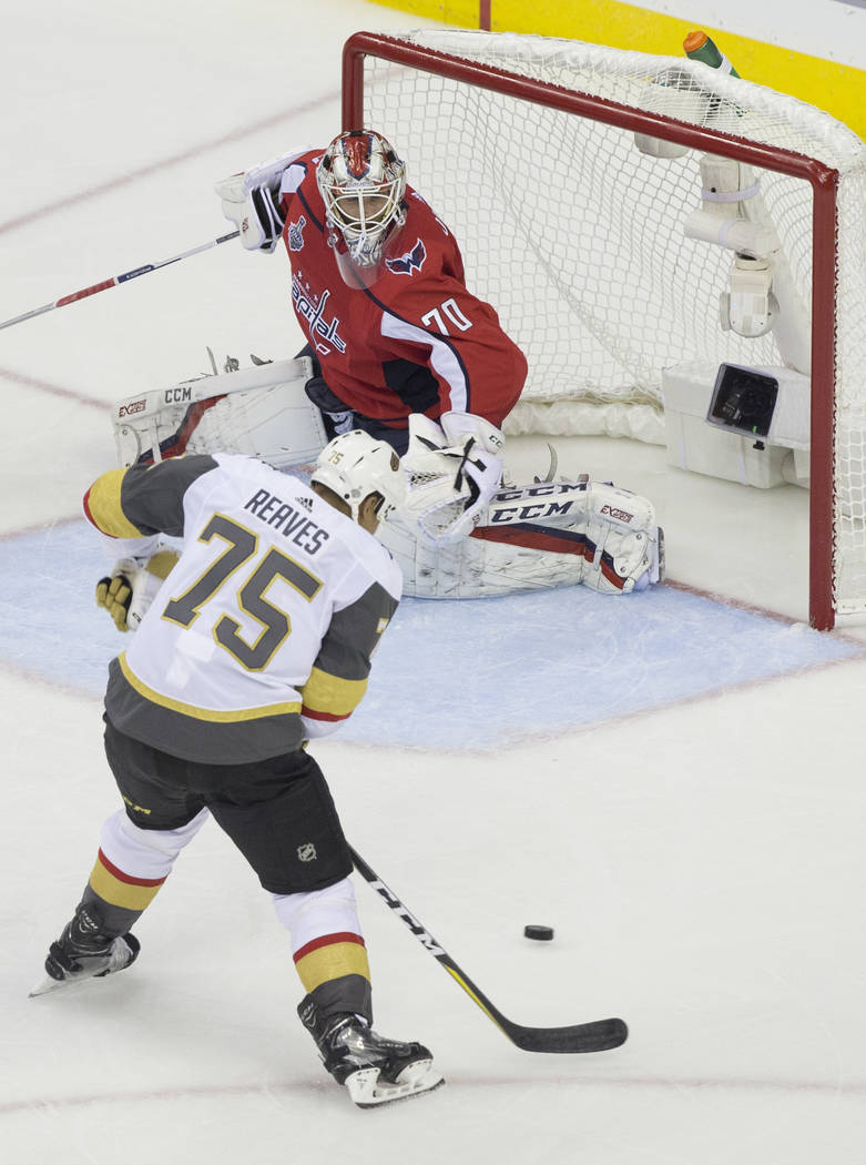 Golden Knights right wing Ryan Reaves (75) shoots on Capitals goaltender Braden Holtby (70) in the second period during Game 3 of the NHL Stanley Cup Final on Saturday, June 2, 2018, at Capital On ...