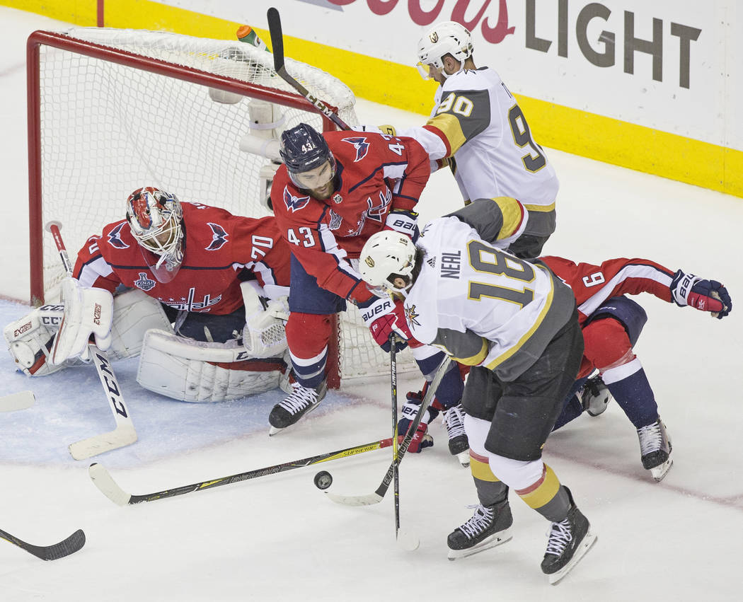 Capitals goaltender Braden Holtby (70) makes a second-period save against Golden Knights left wing James Neal (18) during Game 4 of the NHL Stanley Cup Final on Monday, June 4, 2018, at Capital On ...