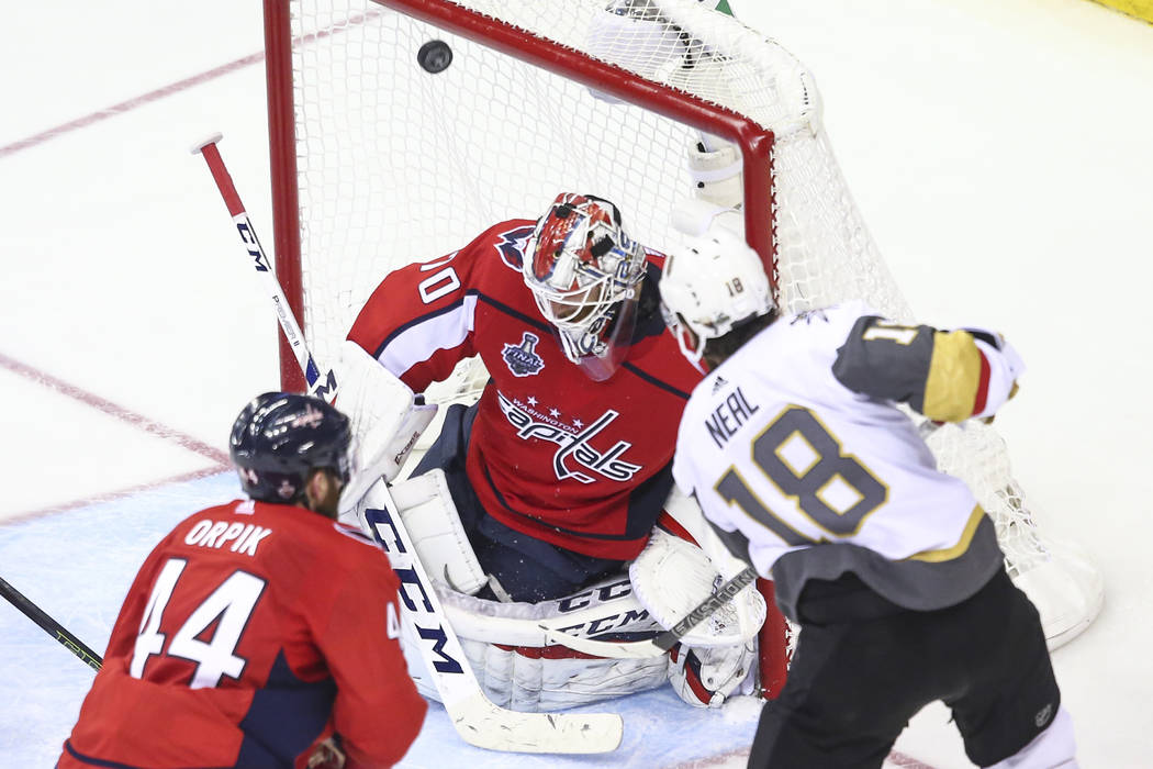 Golden Knights left wing James Neal (18) scores past Washington Capitals goaltender Braden Holtby (70) during the third period of Game 4 of the Stanley Cup Final at Capital One Arena in Washington ...