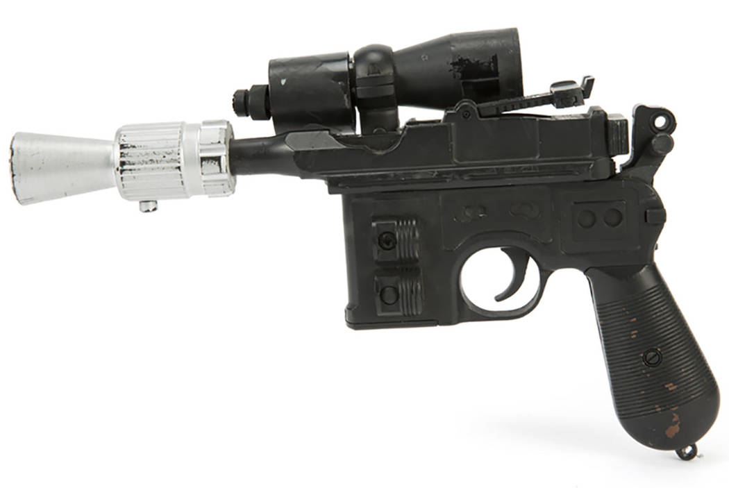"""This photo provided by Julien's Auctions shows character Han Solo's BlasTech DL-44 blaster from the Star Wars trilogy film """"Return of the Jedi"""" (Lucasfilm, 1983) that sold for $550,000 at Julien's ..."""