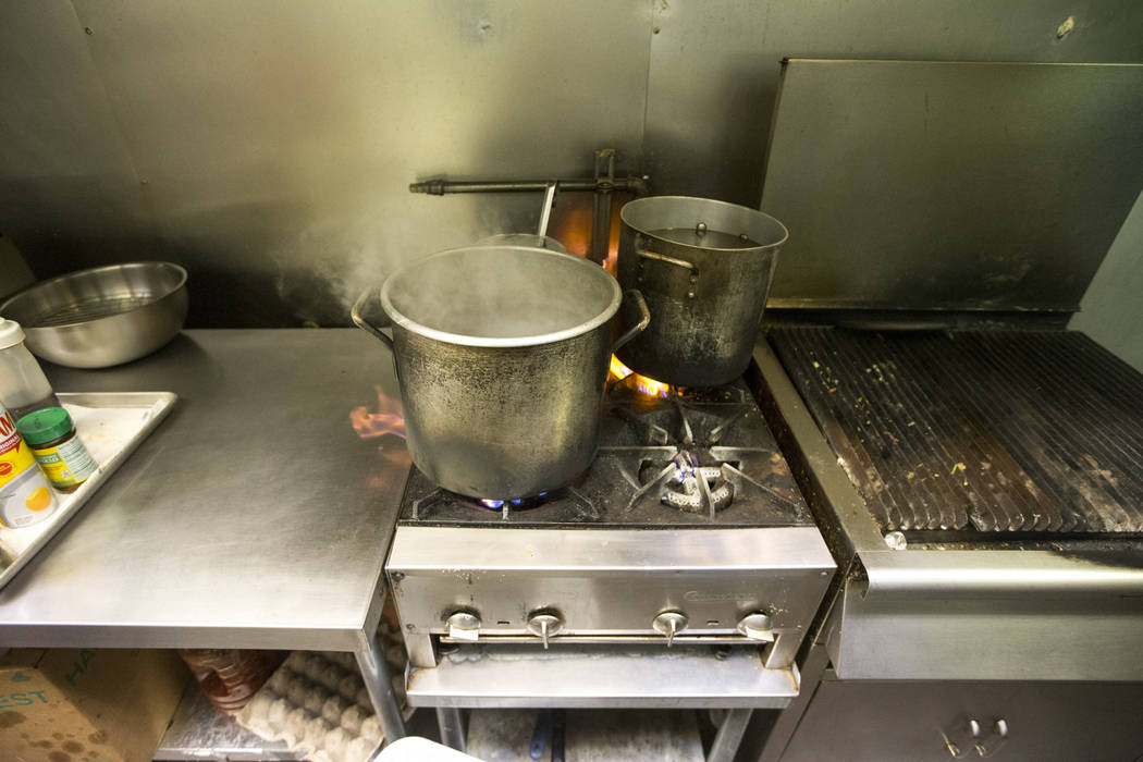 Pots of water boil in the kitchen at Minato sushi bar and Korean BBQ as owner Joan Lee (not shown) prepares for the lunch crowd in Laughlin on Sunday, June 24, 2018. The Las Vegas Valley Water Dis ...
