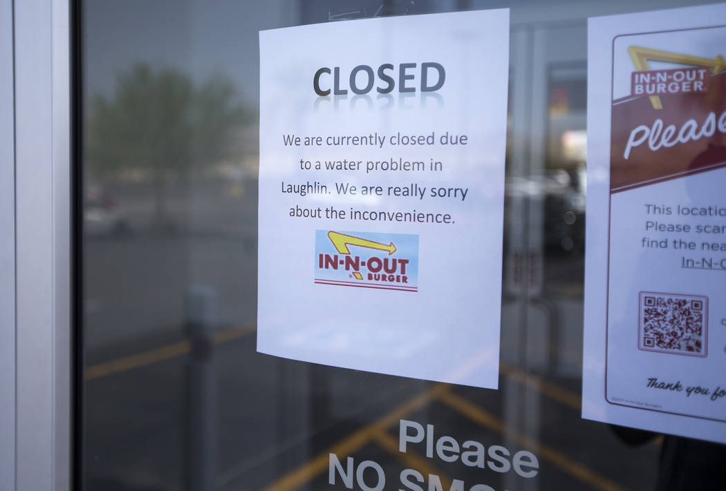A closed for business sign is displayed at an In-N-Out Burger restaurant in Laughlin, Nev., on Sunday, June 24, 2018, after the Las Vegas Valley Water District issued a boil water order after a wa ...
