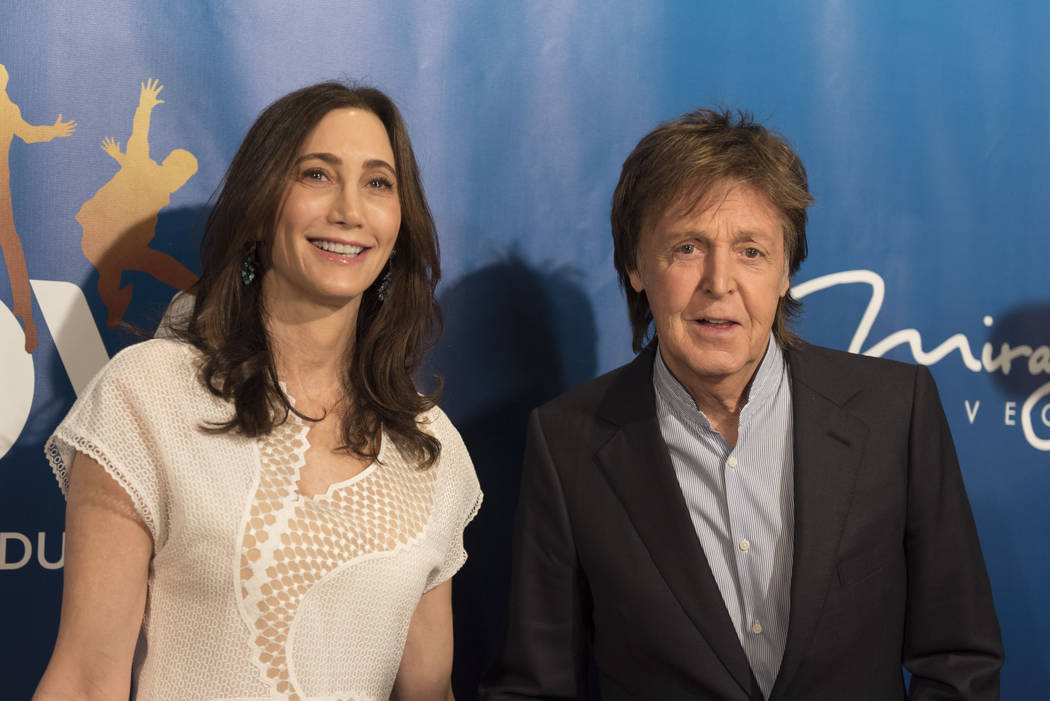 Paul McCartney, right, and his wife Nancy Shevell pose during a red carpet event to celebrate the 10th anniversary of Cirque du Soleil's The Beatles LOVE at The Mirage hotel-casino in Las Vegas Th ...