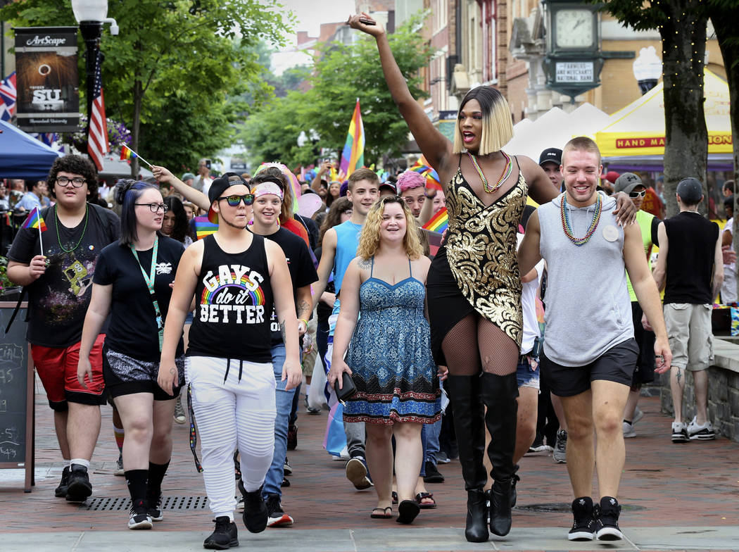 Drag Queen Alicia Wood of Washington, D.C. leads the pride parade down the Loudoun Street Pedestrian Mall in Winchester, Va., Saturday, June 23, 2018, during the city's first Pride Celebration in ...
