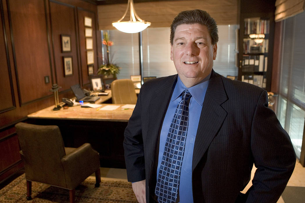 Mike Shustek, owner of Vestin Group, stands in his office, which is covered with sports memorabilia and photographs June 19, 2006. Vestin Group is a prominent hard moneylender who provides key mon ...