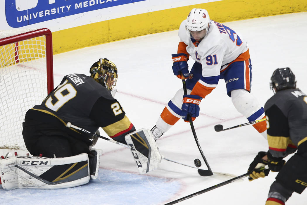 Golden Knights goaltender Marc-Andre Fleury (29) blocks a shot from New York Islanders center John Tavares (91) during an NHL game at T-Mobile Arena in Las Vegas on Thursday, Jan. 25, 2018. Chase ...