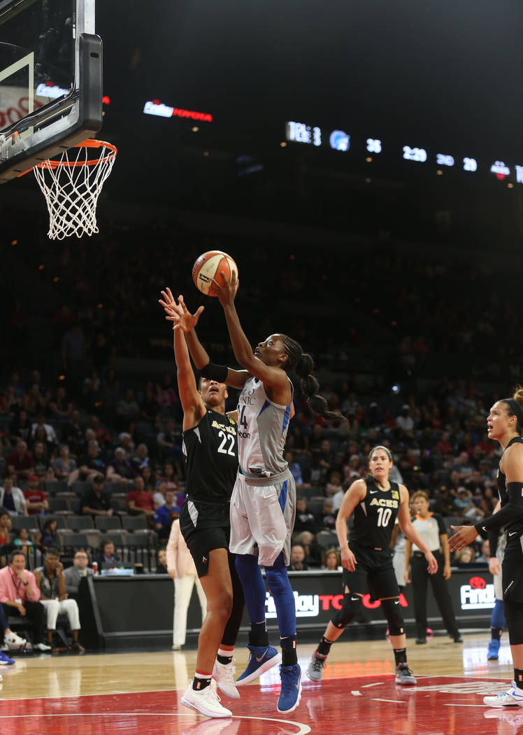 Minnesota Lynx center Temi Fagbenle (14) shoots past Las Vegas Aces center A'ja Wilson (22) in the first half of a WNBA basketball game at the Mandalay Bay Events Center in Las Vegas, Sunday, June ...