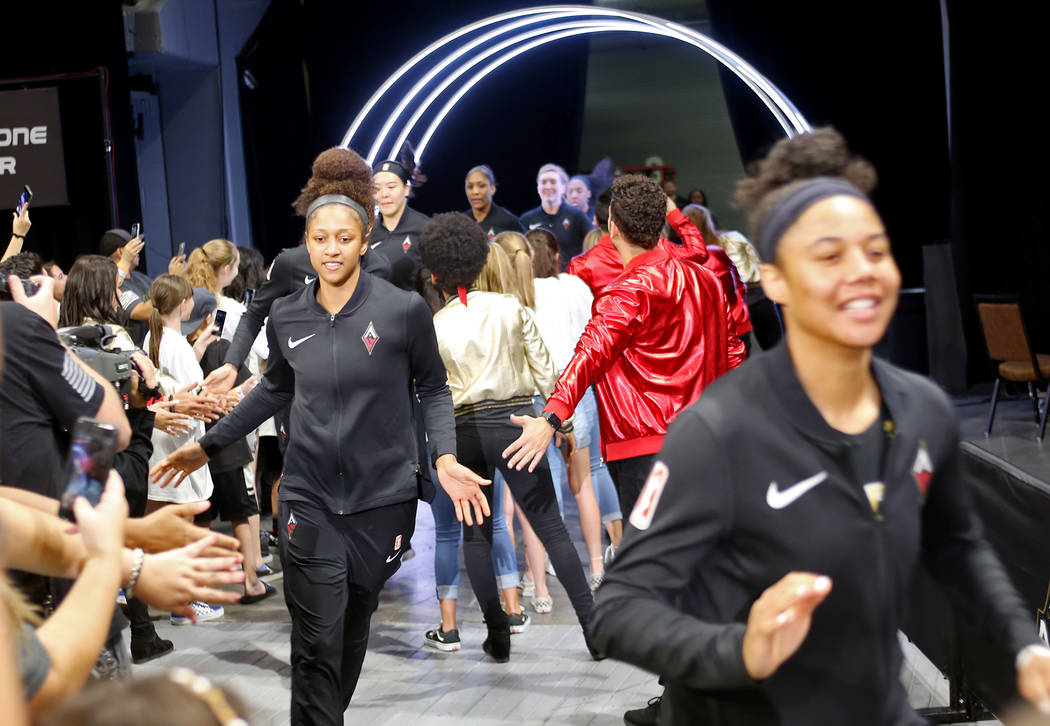 Members of the Las Vegas Aces pass fans as they enter the stadium at a WNBA basketball game at the Mandalay Bay Events Center in Las Vegas, Sunday, June 24, 2018. Rachel Aston Las Vegas Review-Jou ...