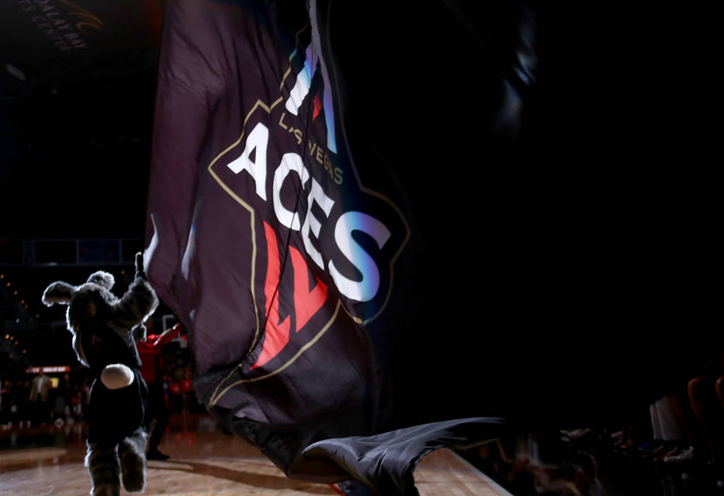 Las Vegas Aces mascot Buckets runs across the floor with a Las Vegas Aces flag before a WNBA basketball game against the Minnesota Lynx at the Mandalay Bay Events Center in Las Vegas, Sunday, June ...