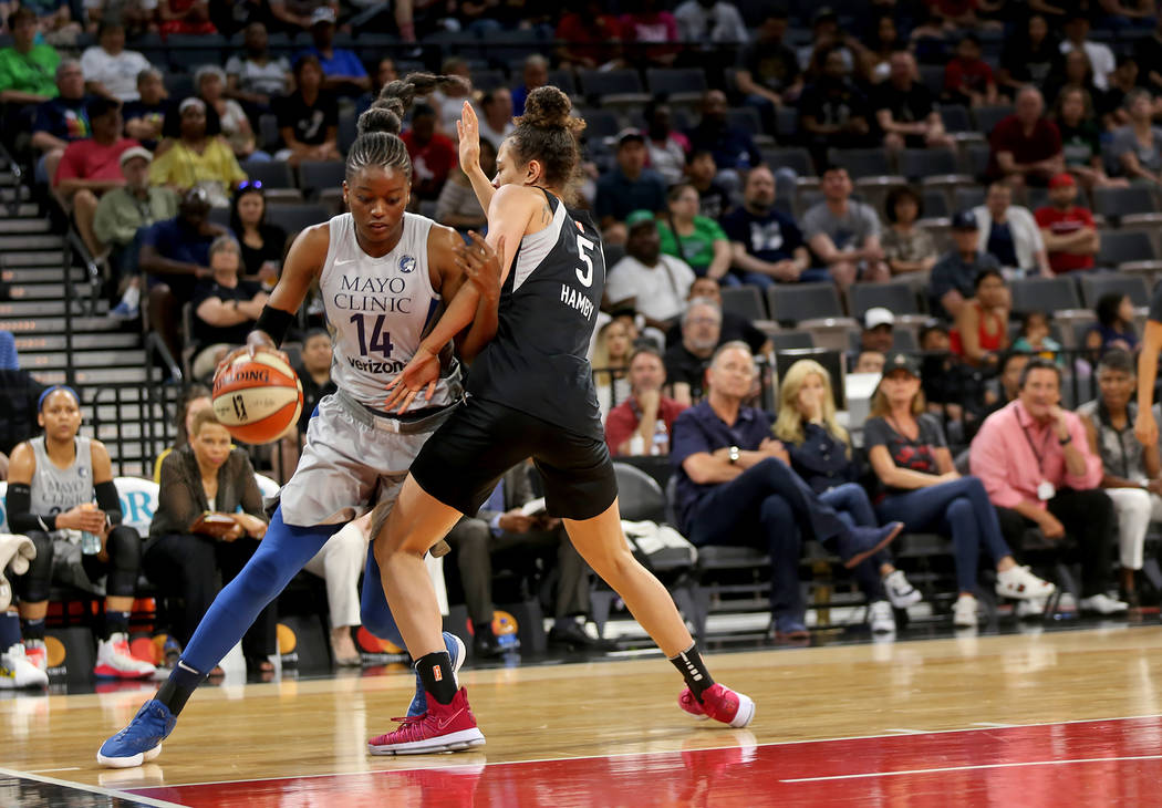 Minnesota Lynx center Temi Fagbenle (14) dribbles around Las Vegas Aces forward Dearica Hamby (5) in the first half of a WNBA basketball game at the Mandalay Bay Events Center in Las Vegas, Sunday ...